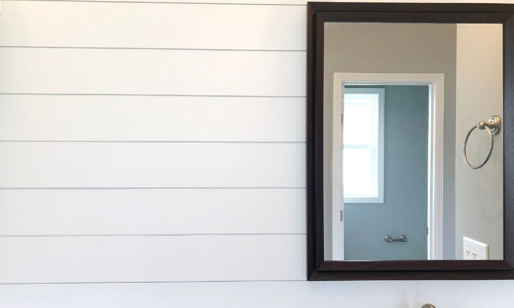 Big-Rectangular-Bathroom-Mirror-Against-A-White-Wall