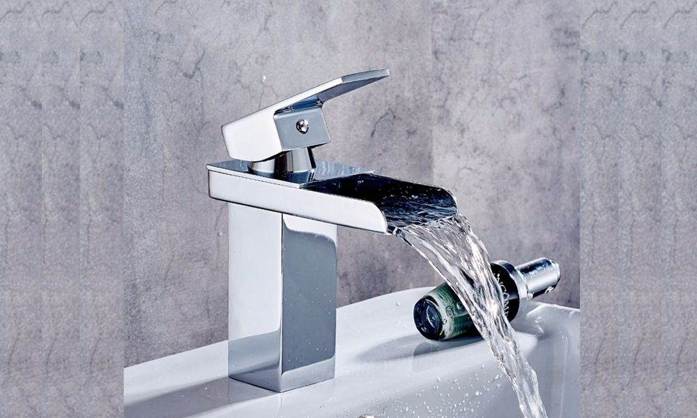 Image-Of-Small-Chrome-Bathroom-Basin-Waterfall-Tap-With-Flowing-Water