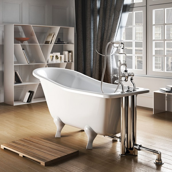 roll top slipper bath with free standing taps in a bedroom
