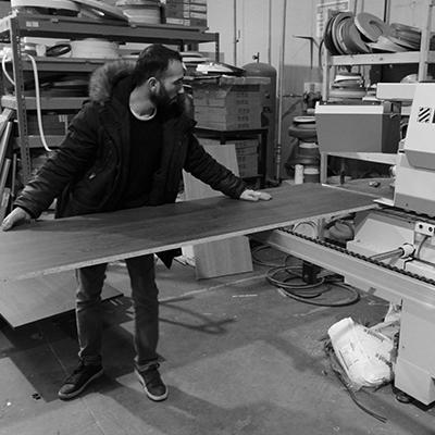 Loading wood panel into CNC machine