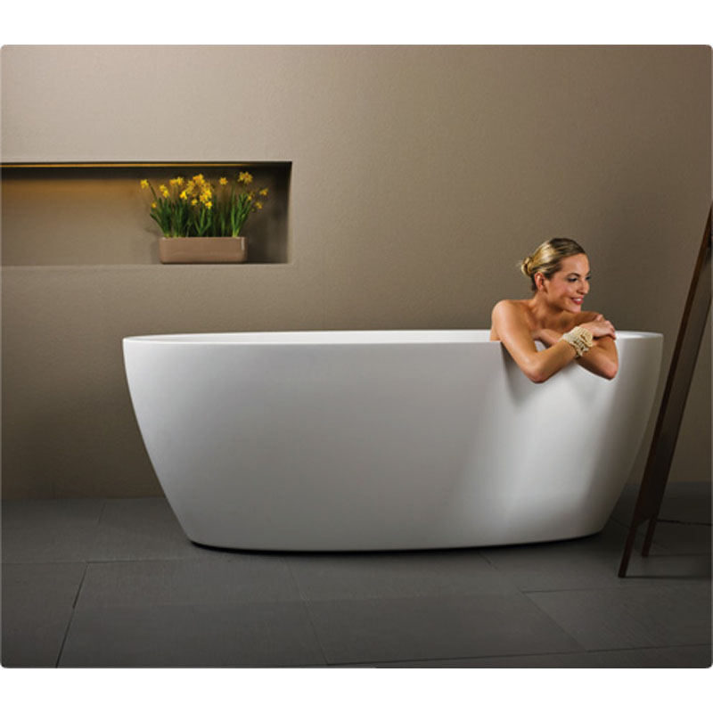 person in a stone free standing bath