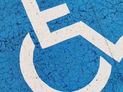 Disabled-Toilet-sign-on-blue-background