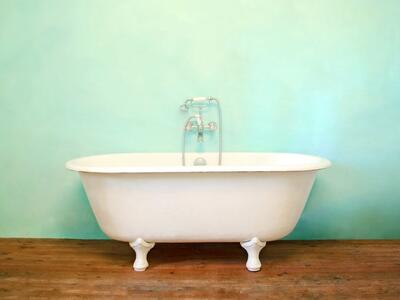 White-Carronite-Bath-against-a-Blue-background
