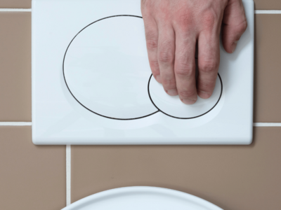 Image-Showing-A-Hand-With-Flushing-Action