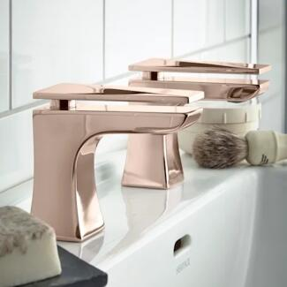Close up of rose gold twin lever taps