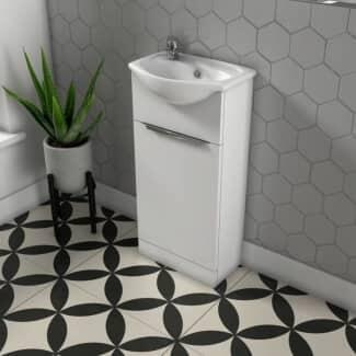 Small grey bathroom basin and unit