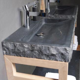 Grey stone marble bathroom basin sitting on a cabinet