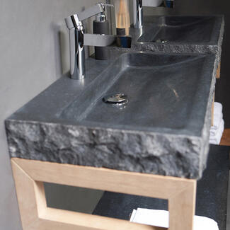 Grey stone marble bathroom basin sitting on a cabinet
