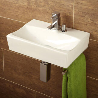 Designer Bathroom Basin hanging on the wall with chrome bottle trap