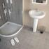 White basin with corner shower