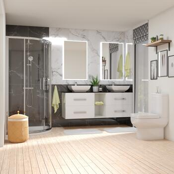 White bathroom shower suite with vanity unit and toilet